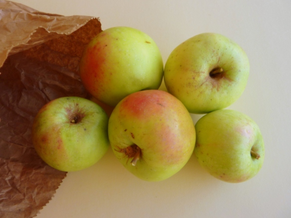 Apples in a paper bag, green apples